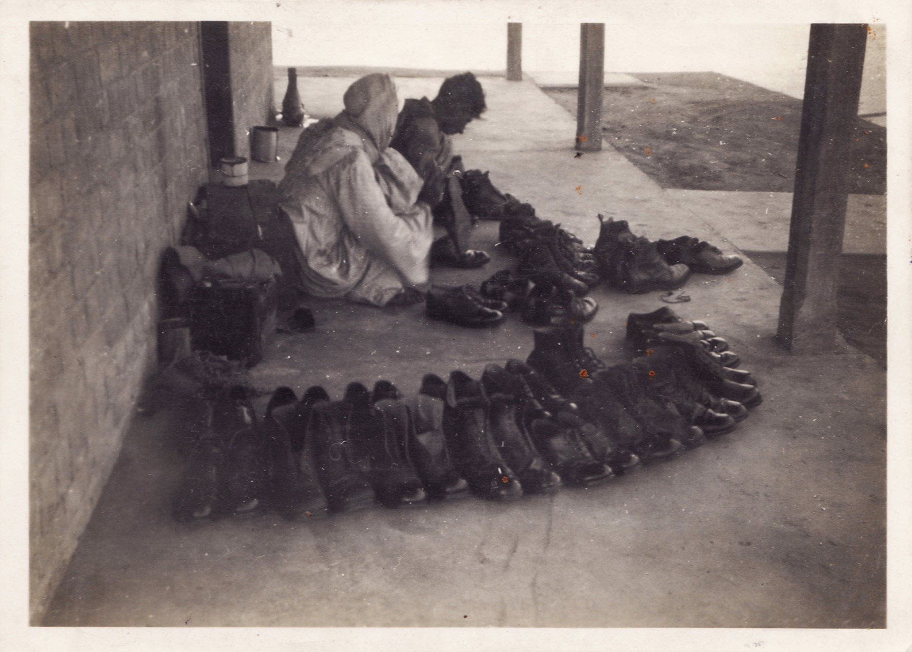 Locals cleaning boots at RAF Abu Sueir