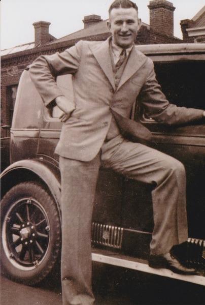 Tom Tobin outside a car